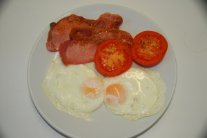Locally sourced free range eggs, with locally sourced bacon and fresh slow grilled tomatoes with sea salt and cracked black pepper